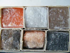 A photograph showing a box of differently coloured rock samples.