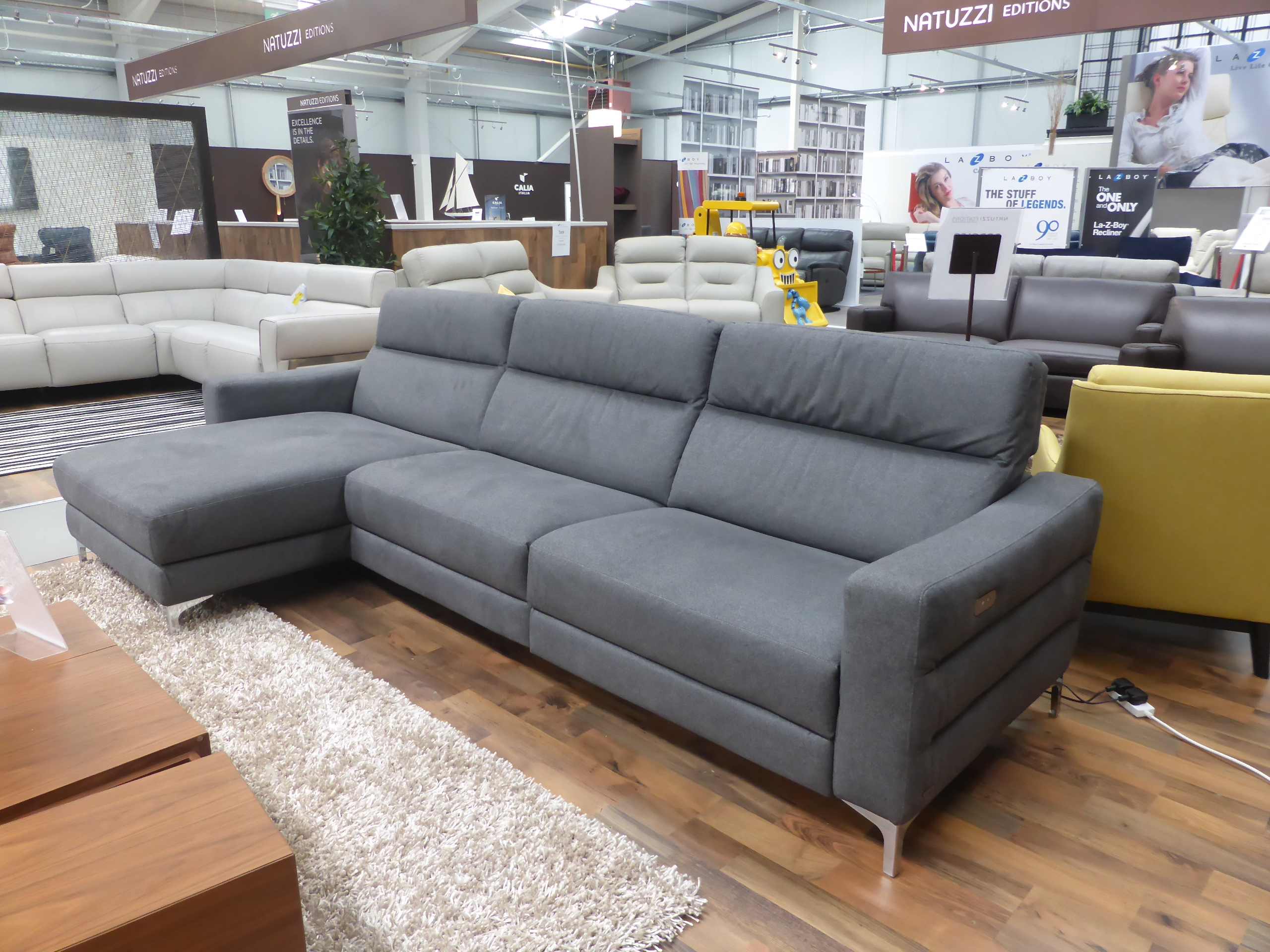 marco cream chaise sofa by factory outlet taupe leather bed natuzzi clearance stock brand new latest model gaspare with power headrest and recliner on each end beautiful italian stone chrome legs