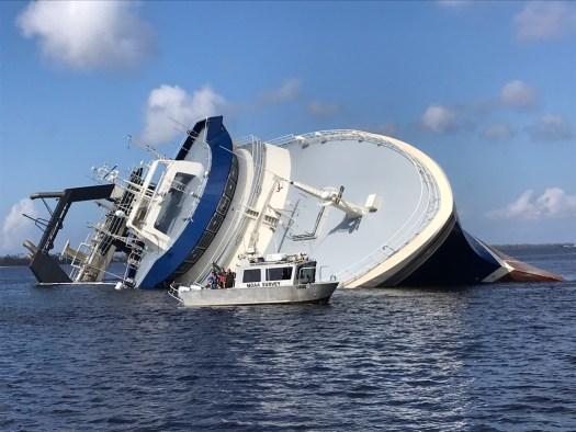 sunken vessel with navigation response team vessel in foreground