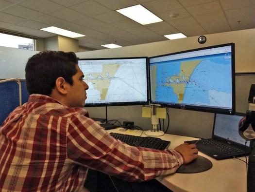 Cartographer Julio Castillo at a workstation.