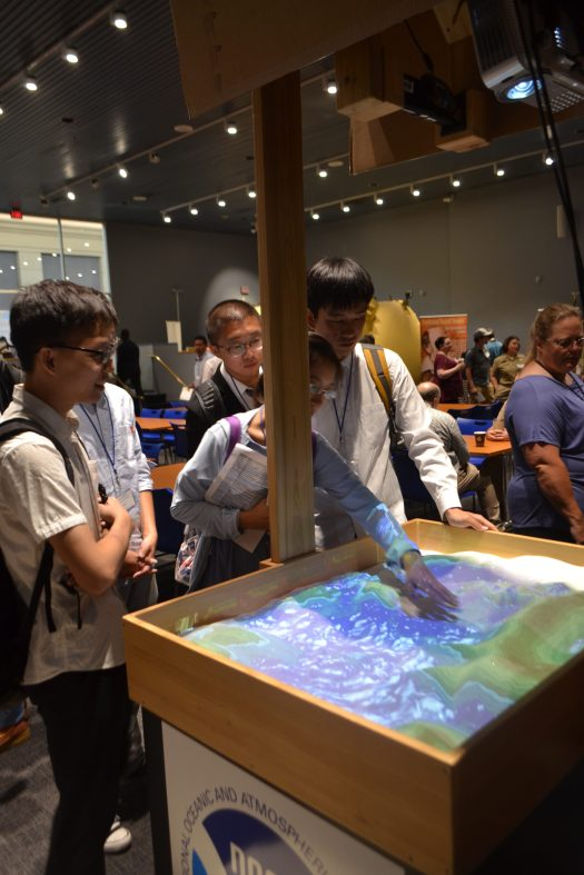 Students with the 3D interactive sandbox.