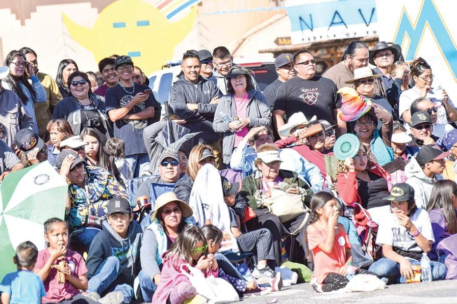 Fairgoers wait in between large gaps in the procession during the 49th annual Western Navajo Fair parade on Saturday morning. This photo was taken at the crowded corner of Main and Edgewater streets.