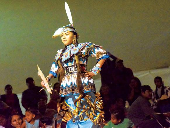 Navajo Times | Krista Allen A young jingle dress dancer sways across the floor during the 49th annual Western Navajo Fair powwow on Saturday night.