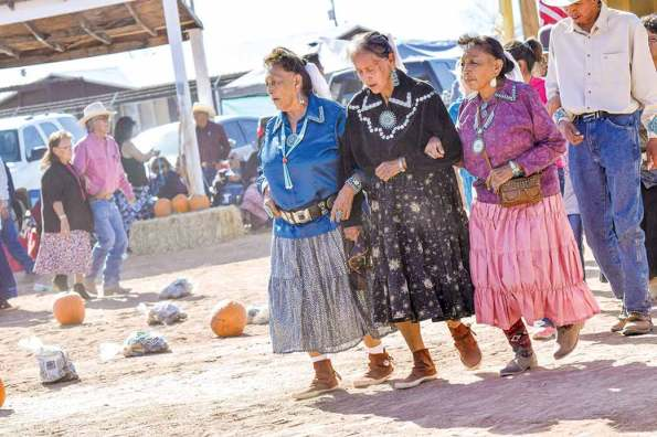 Navajo Times   Krista Allen Showing off their intricate turquoise jewelry, a trio of friends dance in a round of skip dance at the Elder Fest during the 28th annual Utah Navajo Fair on Oct. 27 in Bluff, Utah.