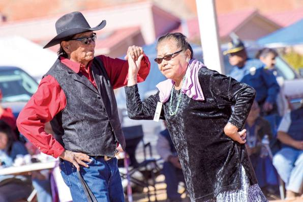 """Navajo Times   Krista Allen Jimmy M. Yazzie, 73, from Oljato-Tsébii'ndzisgaii, Utah, dances with a partner from Fort Defiance during the Elder Fest at the 28th annual Utah Navajo Fair on Oct. 27 in Bluff, Utah. Yazzie is known as the """"Dancing Cowboy."""""""