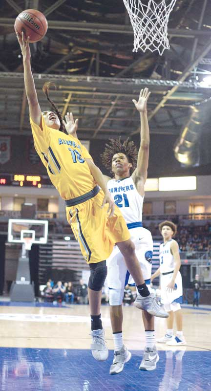 Navajo Times | Donovan Quintero Alchesay's Harley Upton (10) flies by a Paradise Honors Panther defender for a two-point attempt Feb. 23 in Prescott Valley, Ariz.