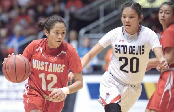 Navajo Times | Donovan Quintero Monument Valley Lady Mustang Tayla Nez (12) drives against Page Lady Sand Devil Myka Taliman (20) Monday during the Arizona 3A girls' championship game at the Gila River Arena in Glendale, Ariz.
