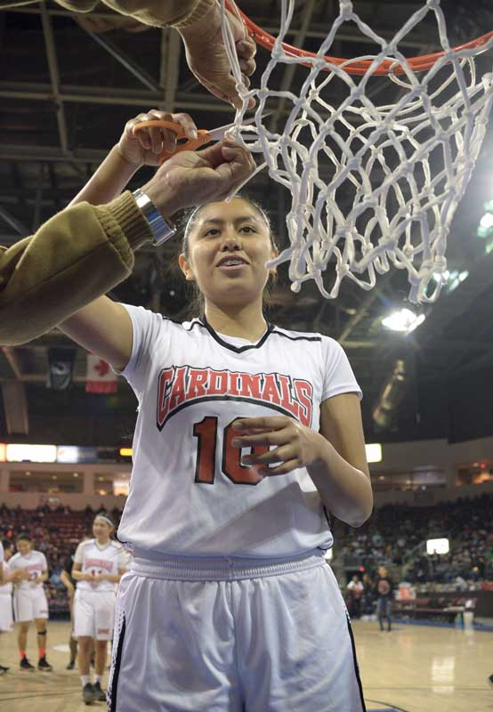 Navajo Times | Donovan Quintero Arizona 1A girls' state champion, St. Michael Lady Cardinal Sydney Terry (10), cuts off a piece of the basketball net Feb. 24 at the Prescott Valley Events Center in Prescott Valley, Ariz.