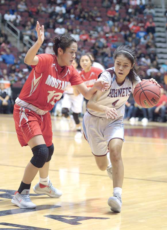Navajo Times | Donovan Quintero Ganado's Deana Curley (4) runs to the sidelines as Lady Mustang Lakeshia Begay (12) guards her Friday at the Gila River Arena.
