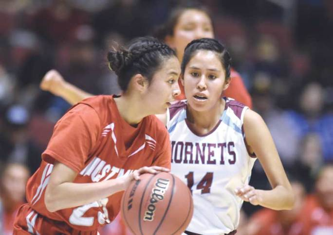 Navajo Times | Donovan Quintero Monument Valley Mustang Adriana Sheppard, left, drives around defending Ganado Lady Hornet Janaya Mcintosh (14) Friday during the Arizona 3A girls semifinals in Glendale, Ariz. The Lady Mustangs defeated the top seed Ganado Lady Hornets and advanced into the final round against the Page Lady Sand Devils.