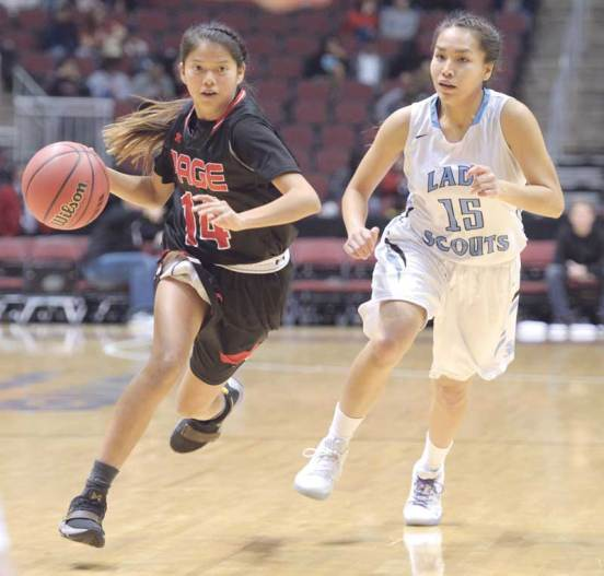 Navajo Times | Donovan Quintero Page Lady Sand Devil Nadya Begay (14) dribbles by Window Rock Lady Scout Halaya Talkalai (15) Friday during the Arizona 3A girls semifinals in Glendale, Ariz.