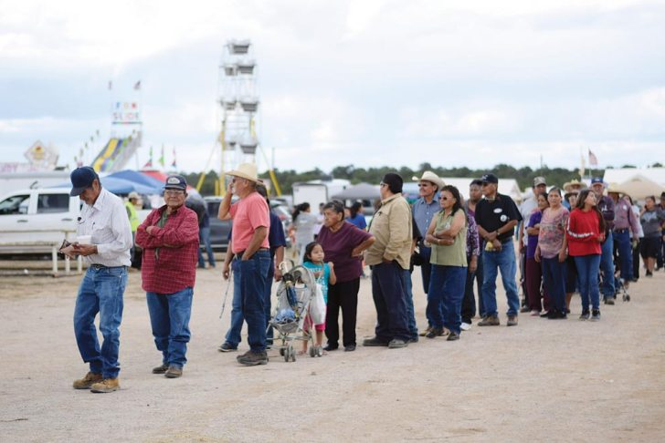 Navajo Times | Ravonelle Yazzie Fair goers line up for the free barbeque at the Ramah Navajo Fair and Rodeo on Aug. 24.