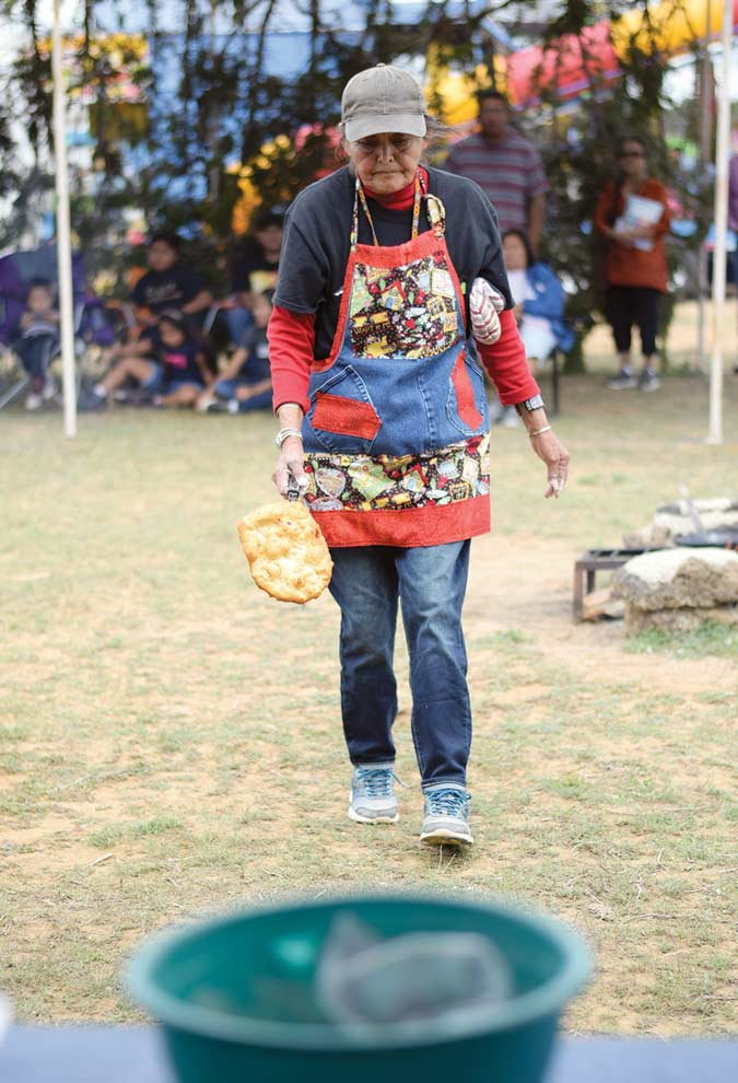 Navajo Times | Ravonelle Yazzie Mary D. Pino brings her last frybread to the judges' table during the frybread contest at Ramah Navajo Fair and Rodeo in Pine Hill, N.M., on Aug. 25.