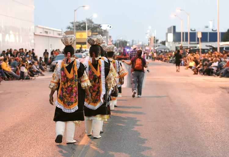 Navajo Times | Donovan Quintero The Zuni Olla Maidens walk down the parade route during the night parade Aug. 9 at the Gallup Inter-Tribal Indian Ceremonial.