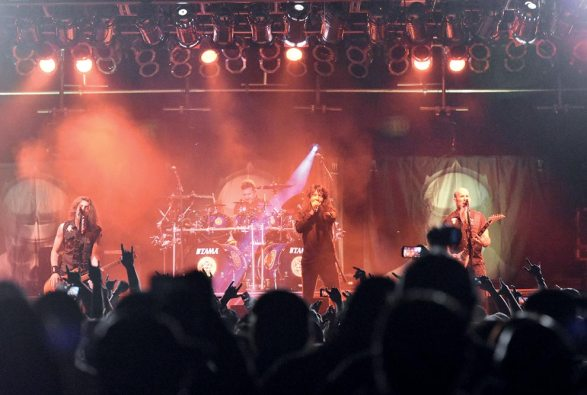 Navajo Times | Donovan Quintero Anthrax band members, from left, Frankie Bello, Charlie Benante, Joey Belladonna and Scott Ian rile thousands of fans with their legendary music on Friday night during the 72nd annual Navajo Nation Fair in Window Rock.