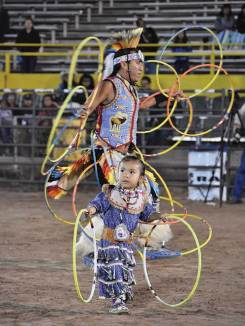 Navajo Times | Rima Krisst World Champion hoop dancer Tony Duncan keeps pace with his daughter, Mia Duncan, the youngest member of his family dance group.