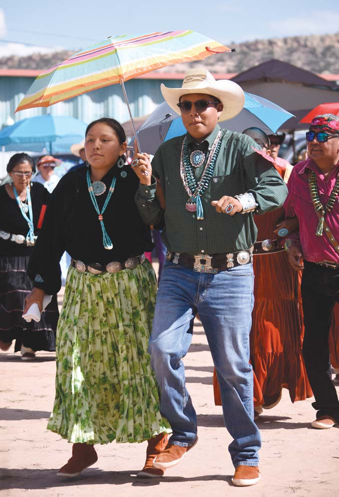 Navajo Times | Ravonelle Yazzie Song and dancers put pep in their step as they compete at this year's Navajo Nation Fair song and dance in Window Rock on Saturday.