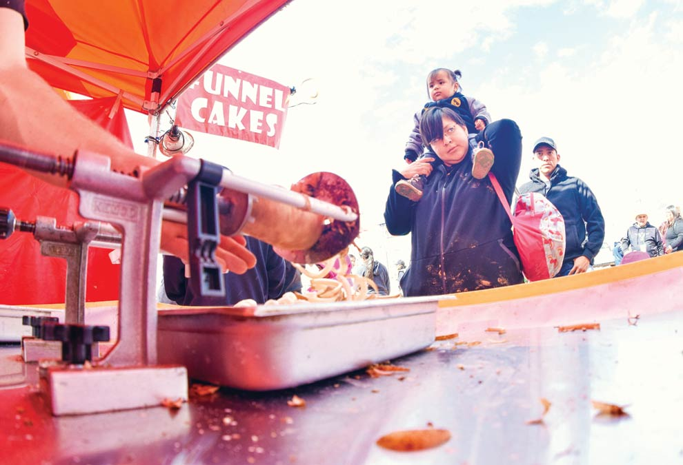Navajo Times | Krista Allen Fairgoers wait in line for curly fries during Kids Day at the 50th annual Western Navajo Fair on Oct. 11.