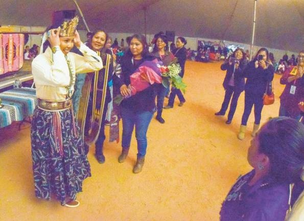Navajo Times | Krista Allen Newly crowned Miss Western Navajo Raquel White Hair, 19, from Kayenta, adjusts her crown after winning the title inside the powwow tent at the 50th annual Western Navajo Fair on Saturday night.