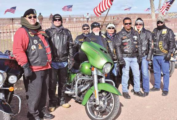 Navajo Times   Rima Krisst Navajo-Hopi Honor Riders and leaders Veterans Helping Veterans and Endless Riders gather at Gallup's Hillcrest Cemetery to honor late and fallen veterans. Left to right are David Cuellar, Mike Withstandley, Orion, Troy (Hammer) Essary, Judy Buffalohead, Thomas Clark, Erika Stevens and Frank Chiapetti.