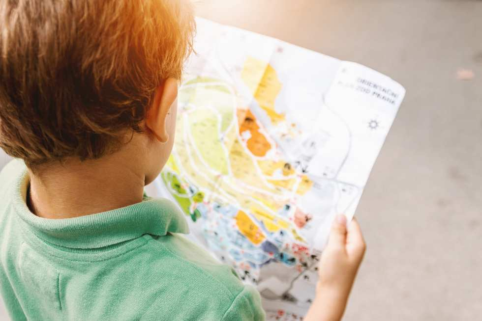 child with map for road trip