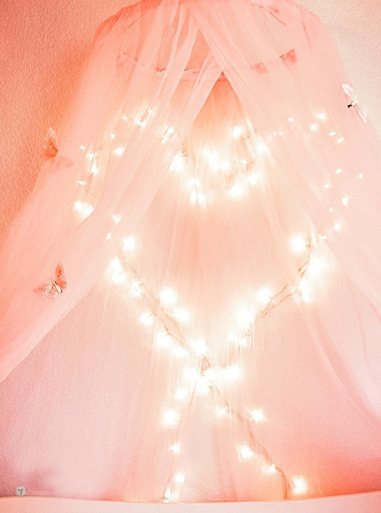 close up of heart shaped lights on wall