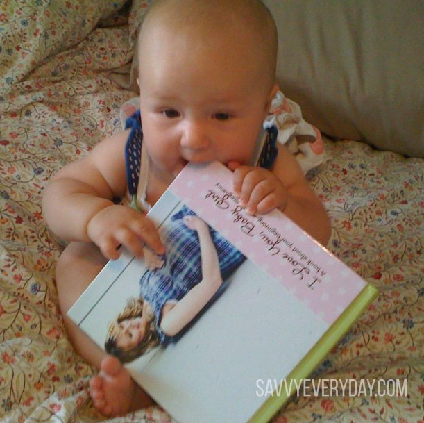 Baby eating book