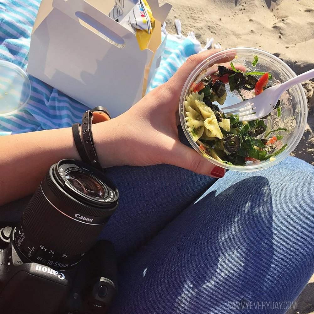 Eating 5th Avenue Deli lunch on the beach