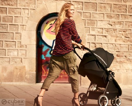 mom walking with Cybex stroller