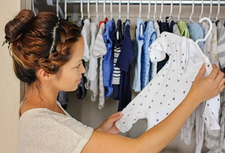 katrina looking at baby clothes