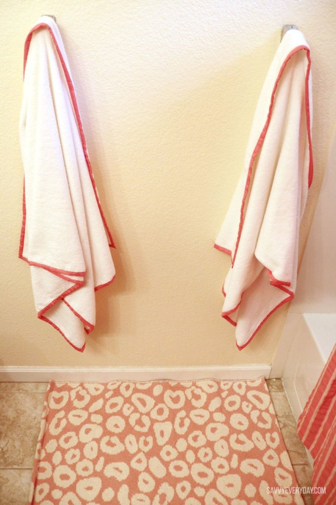 hanging towels over spot rug