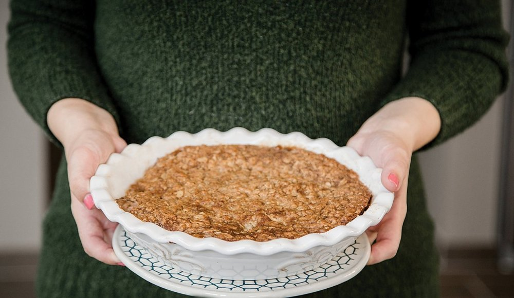 holding apple crumble pie