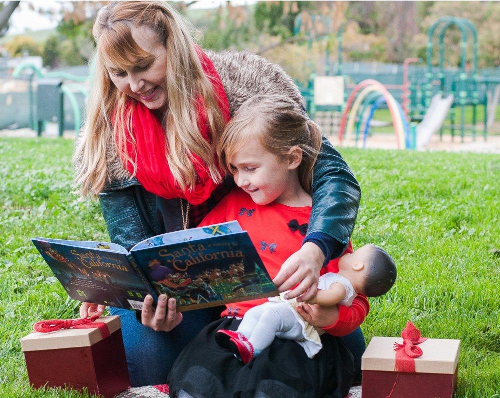 reading a Santa book to the kiddo