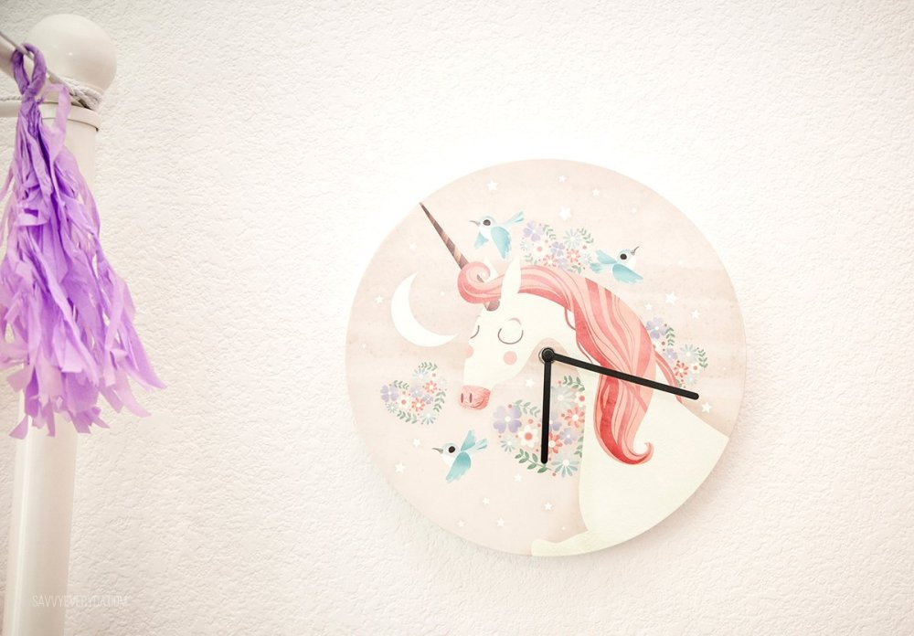 Mouse + Magpie Unicorn Ride Clock on the wall