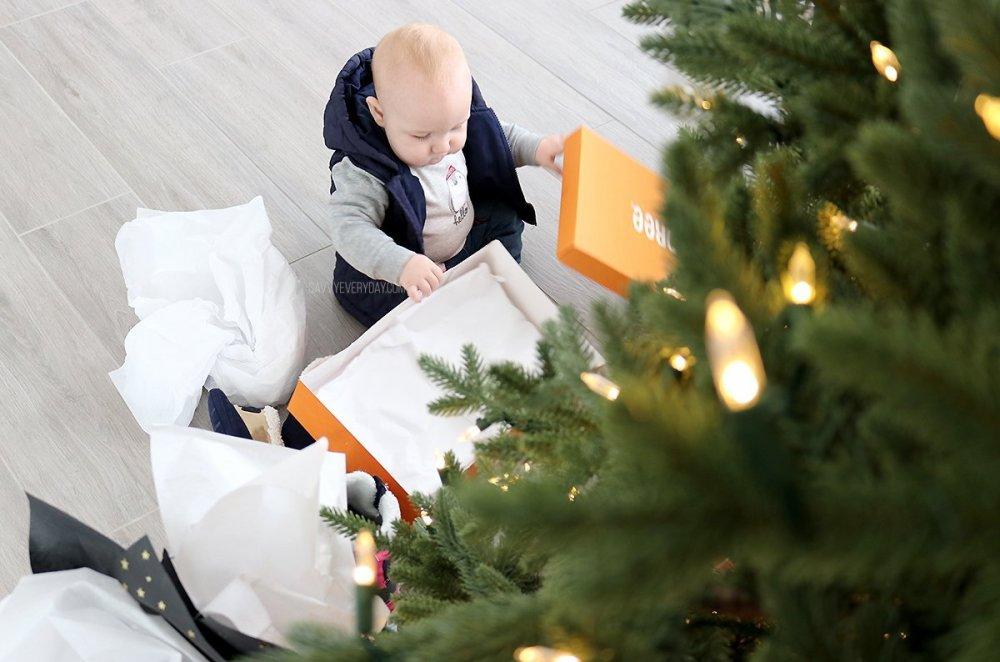baby opening orange Gymboree box