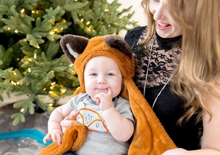 baby in fox onesie and hooded fox blanket
