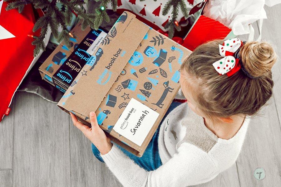 Savannah holds her prime book box