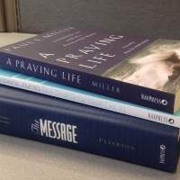 A stack of NavPress books