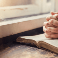 31 Days of Prayer | The Navigators Evangelism Resources | hands on a windowsill, clasped hands praying on an open bible