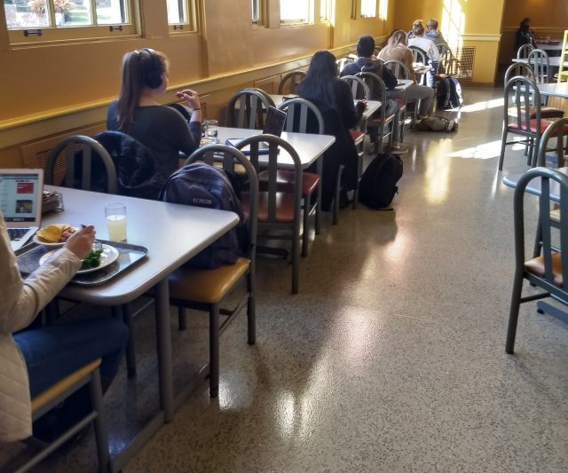 A Seat At God's Table The Navigators College students sitting in cafeteria style room alone at separate tables loneliness epidemic