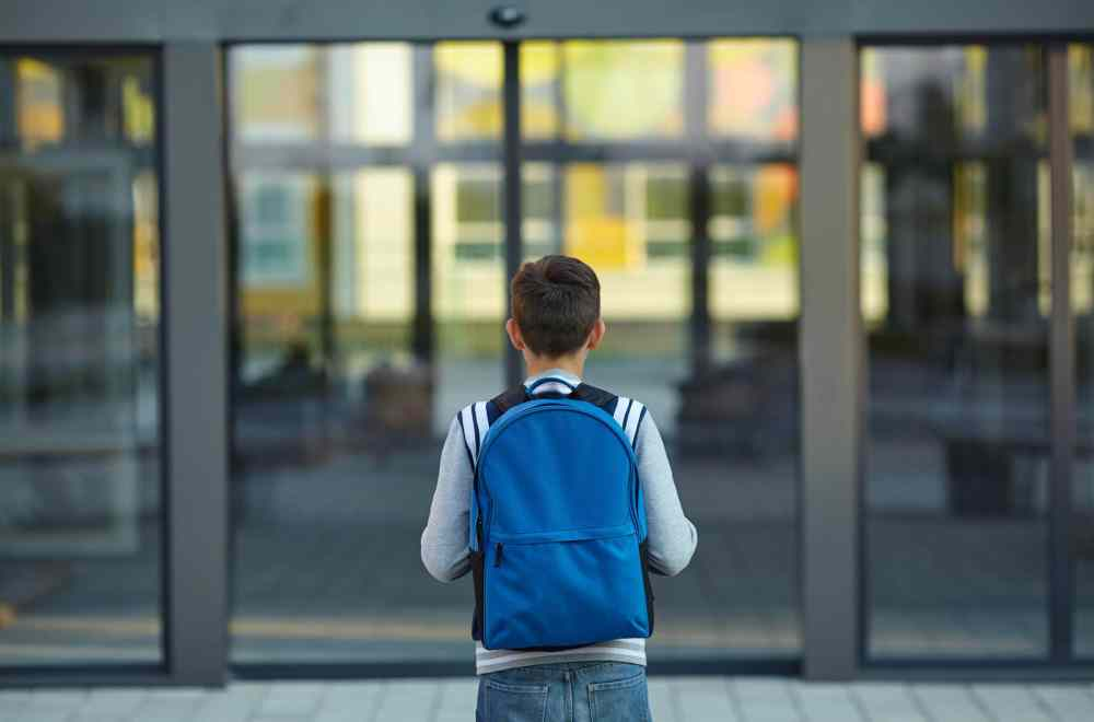 Unexpected Fruit Lesley Wolfe Navigators Neighbors Boy in front of school
