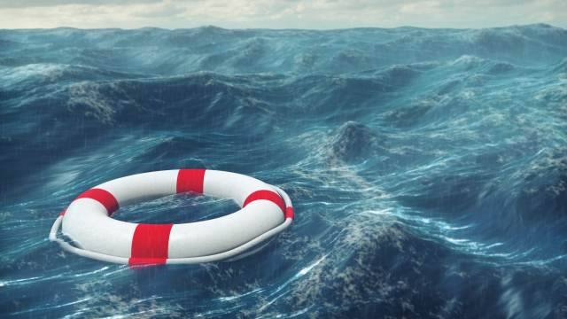 Buoyant in Turbulent Times | Doug Nuenke | Floating lifebuoy on a stormy sea.