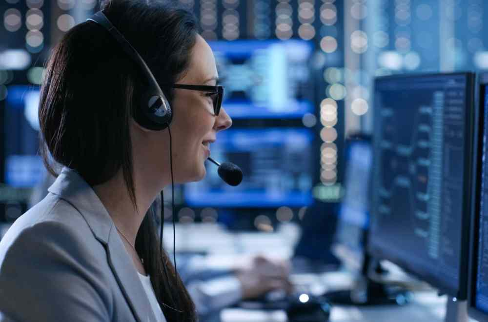 The Real Lives Behind a 911 Call | Navigators First Responders Ministry | Female 911 dispatcher on the phone