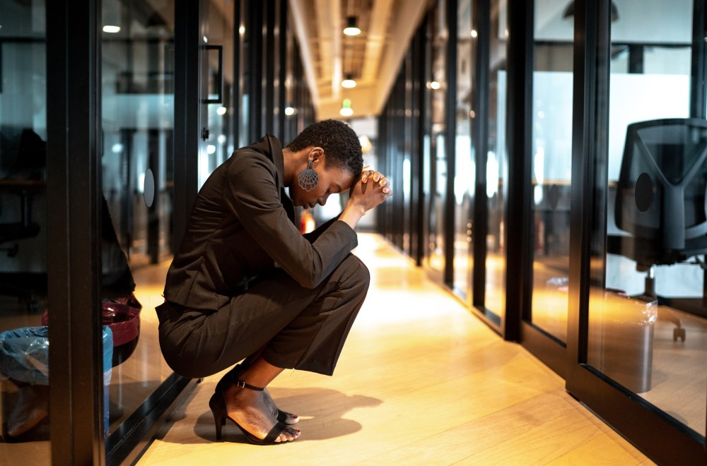 Suddenly Unemployed: A Fresh Way to Pray the Lord's Prayer | Worried young businesswoman at corridor office