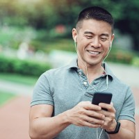Luebe Brothers Podcast | The Navigators | Asian ethnicity man listening to his phone in the park