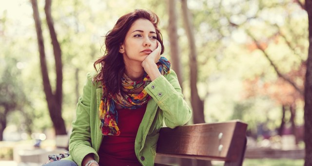 Mental Health: How to Cope with Depression and Anxiety | Unhappy girl sitting at bench