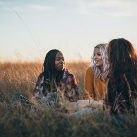 Asking Great Questions to Live Out Scripture | Navigators Bible Study Resource | Three hiker girls taking a rest from long walking through African savanas