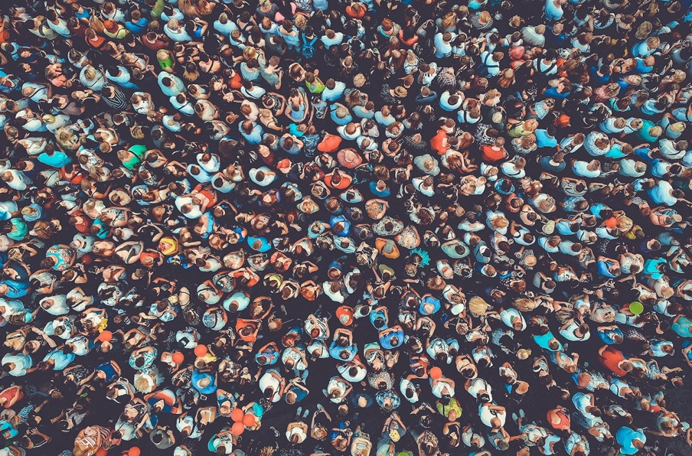 Multiples of One Million | Doug Nuenke | People crowd texture background. Bird eye view.