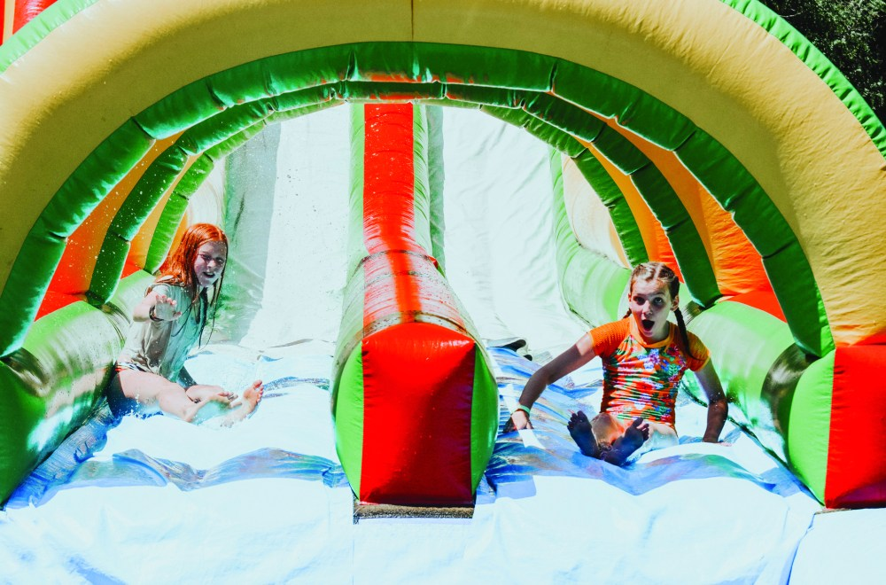 Summer Camp: A Week of Good News and Fun | Eagle Lake Camps | Children having fun on a bounce house in the Summer