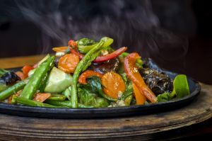 Sizzling vegetables steaming asian